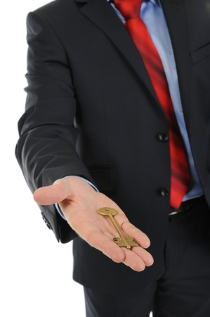 businessman gives the key photo