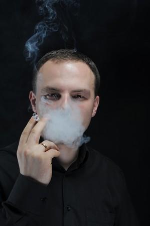 young man smokes a cigarette Stock Photo - 8182052