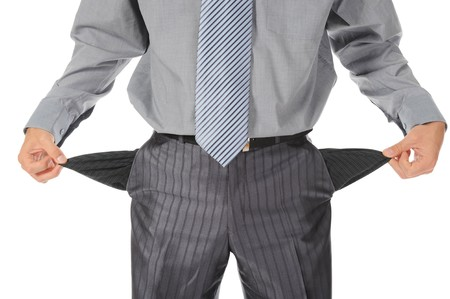 Businessman with empty pockets Stock Photo