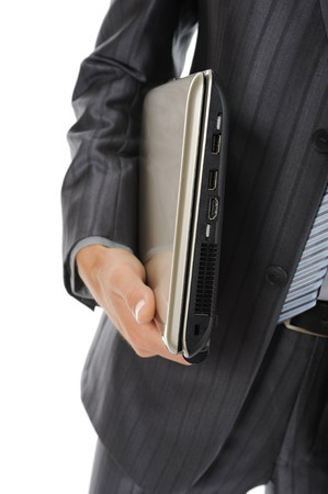 Businessman holding laptop photo