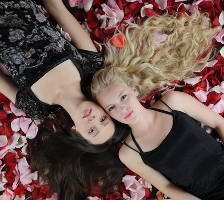 beautiful women in rose petals photo