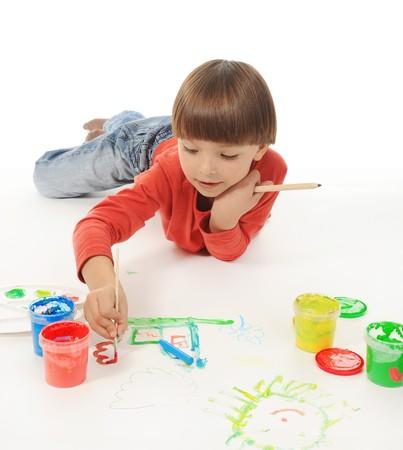 drawing up: little boy paints