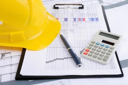 engineering clipboard: helmet on the table Stock Photo