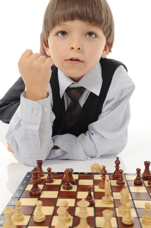 schoolboy playing chess photo