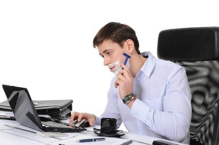 Businessman shaves in the workplace Stock Photo - 8260082