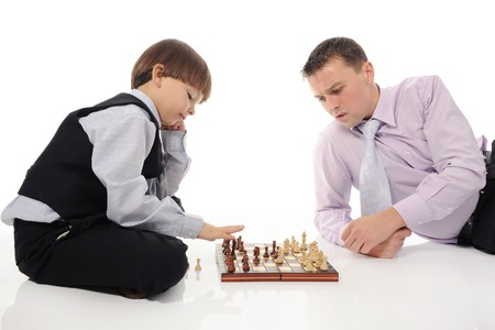 Dad and son playing chess photo