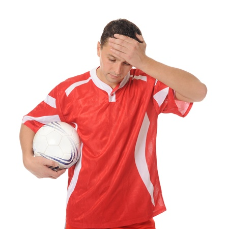 Upset soccer player in the red form. Stock Photo - 8260139