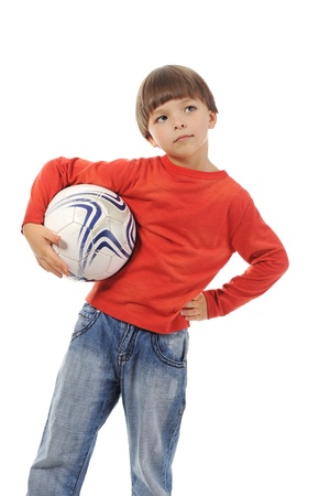 Cheerful boy with a soccer ball photo