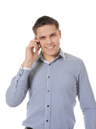 smiling young man talking on the phone Stock Photo - 8260327