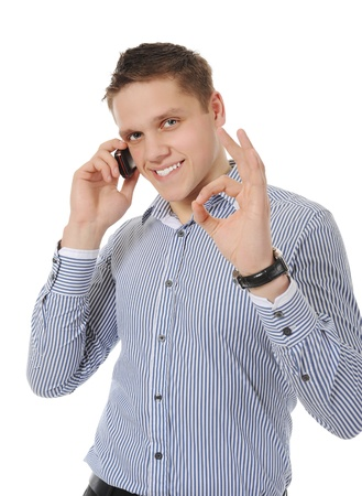 smiling young man talking on the phone photo