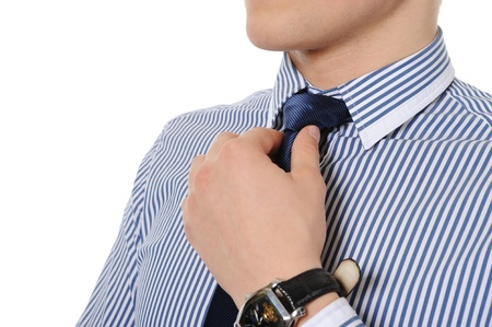 picture of a business man adjusting his tie photo