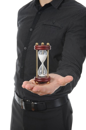 Businessman with hourglass in hand. photo