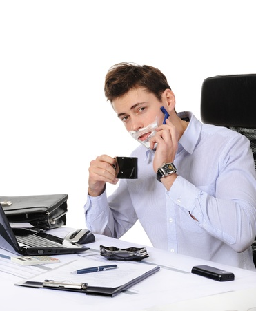Businessman shaves in the workplace photo