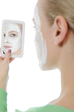 young woman making a mask photo