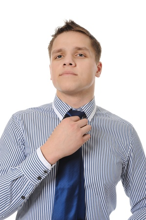 loosen: picture of a businessman adjusting his tie. Isolated on white background