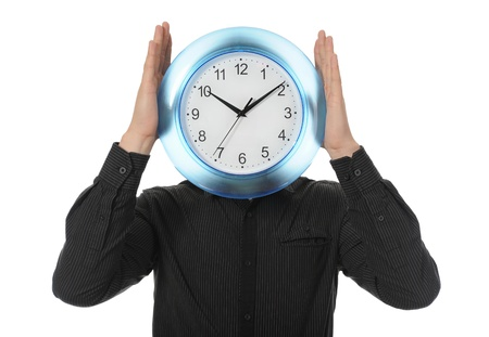 punctuality: man in a black shirt holds clock