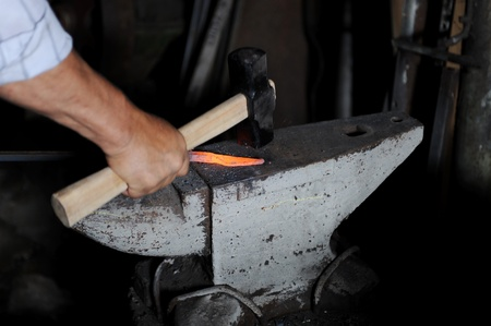 Making a decorative element in the smithy on the anvil Stock Photo - 8260565