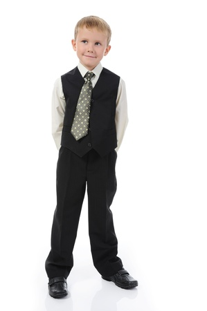 Boy in the fashionable suit. Isolated on white background photo
