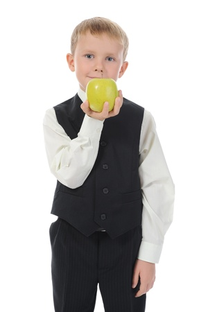 boy holds an apple. Isolated on white background photo