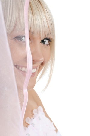 Young bride with veil. Isolated on white background photo