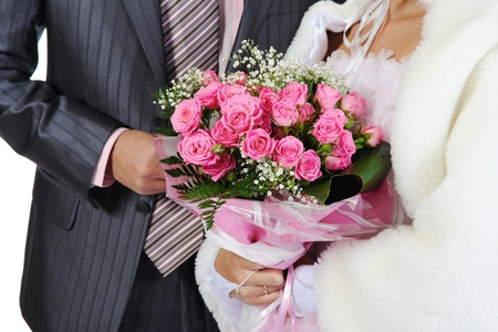 Married with a bouquet of pink roses. Isolated on white background photo