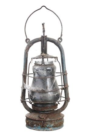Old kerosene lamp. Isolated on white background photo
