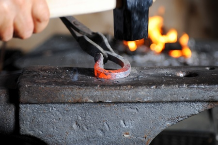 Making a decorative element in the smithy on the anvil Stock Photo - 8260583