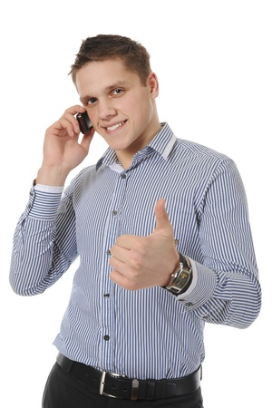 smiling young man talking on the phone. Isolated on white background photo