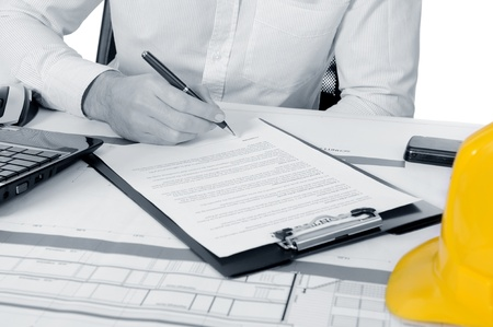 yellow construction helmet on the table builder Stock Photo - 8260569