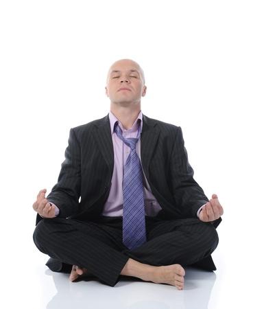 meditation isolated white: businessman meditating in yoga lotus. Isolated on white background