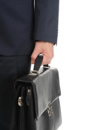 black briefcase: Imagen de un hombre de negocios sosteniendo un malet�n. Aislados en fondo blanco Foto de archivo