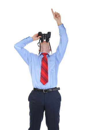 Image of a businessman looking up through binoculars. Isolated on white background photo