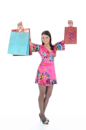 beautiful young woman in a full-length with shopping bags. Isolated on white background Stock Photo - 8355431