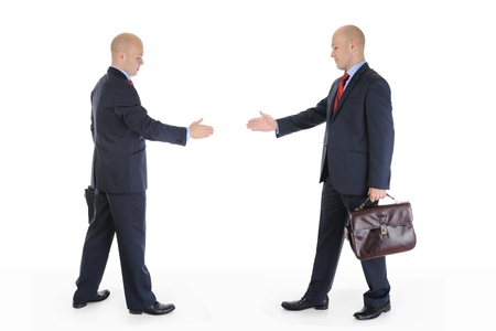Two businessmen stretched out their hands for a handshake. Isolated on white background photo