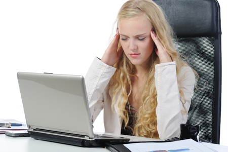 doldrums: tired young blonde woman in the office at the workplace suffers headaches. Isolated on white