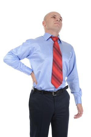 back strain: Young businessman with strong back pain. Isolated on white background
