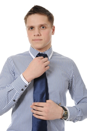 picture of a businessman adjusting his tie. Isolated on white background photo