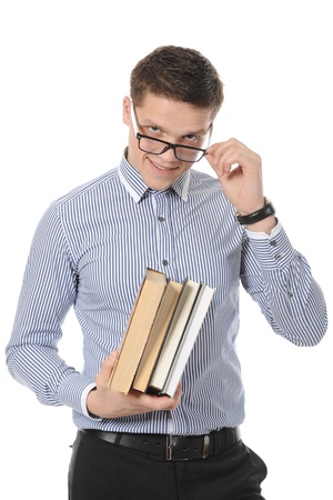portrait of a smiling young man with books. Isolated on white background Stock Photo - 8355541