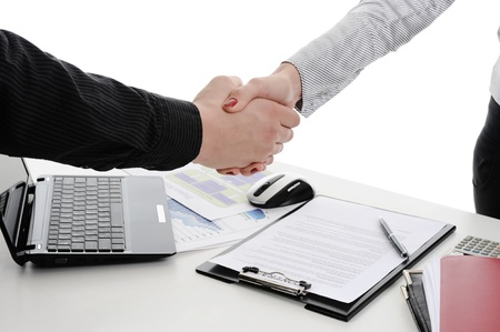 Handshake of business partners, when signing documents. Isolated on white background photo