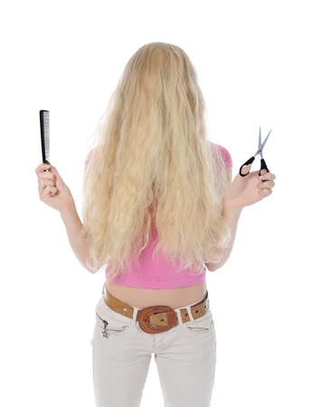woman with backcombing hair and scissors. Isolated on white background photo