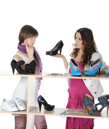 beautiful brunette young woman choosing shoes at a store. Isolated on white background photo