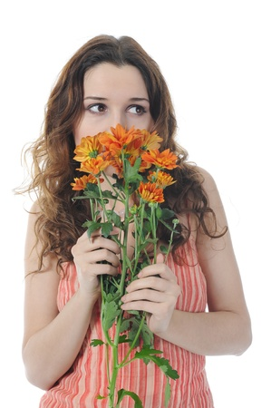 Beautiful brunette woman with a bouquet of flowers in their hands. Isolated on white background Stock Photo - 8355595