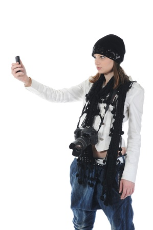 woman makes the photo on his phone. Isolated on white background photo