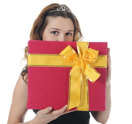 Long-haired brunette in pink dress with a gift box. Isolated on white background photo