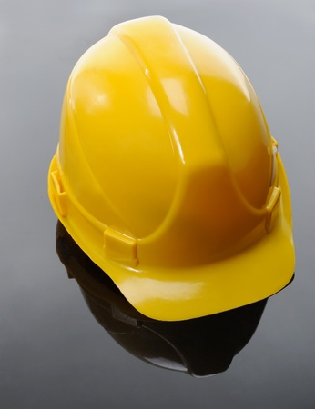 Image of yellow construction helmet on a black background photo