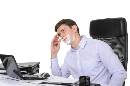 Businessman shaves in the workplace. Isolated on white background Stock Photo - 8355591