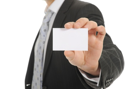 business card in hand: Image of a businessman holding a blank in the hand. Isolated on white background Stock Photo