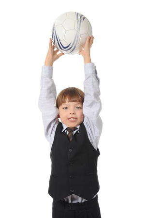 Cheerful boy with a soccer ball in his hand. Isolated on white background photo
