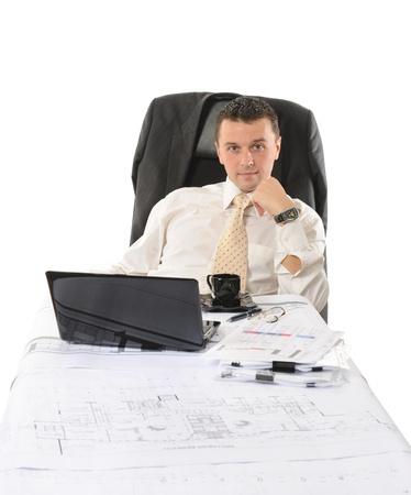 Businessman sitting before a computer. Isolated on white background Stock Photo - 8355606