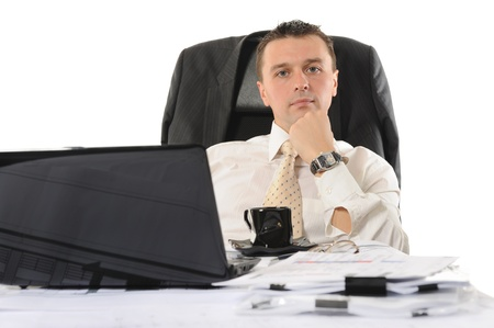 Businessman sitting before a computer. Isolated on white background Stock Photo - 8355617